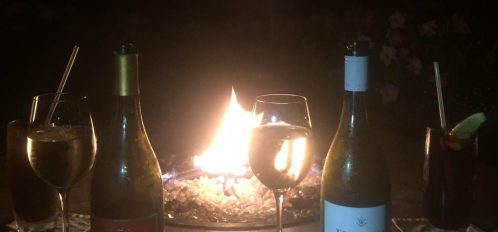 bottles of wine by fire