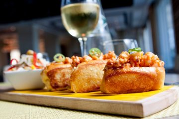 Gourmet mini lobster rolls and a glass of wine at Cape Cod Restaurant