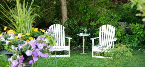 two Adirondack chairs to relax in the garden