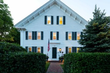 The front of The Inn at Yarmouth Port at twilight