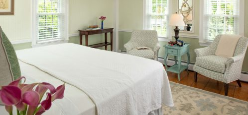another view of The Cotuit Room at The Inn at Yarmouth Port including bed and seating area