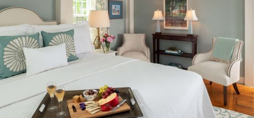 view of the bed in The Salt Pond Room at The Inn at Yarmouth Port