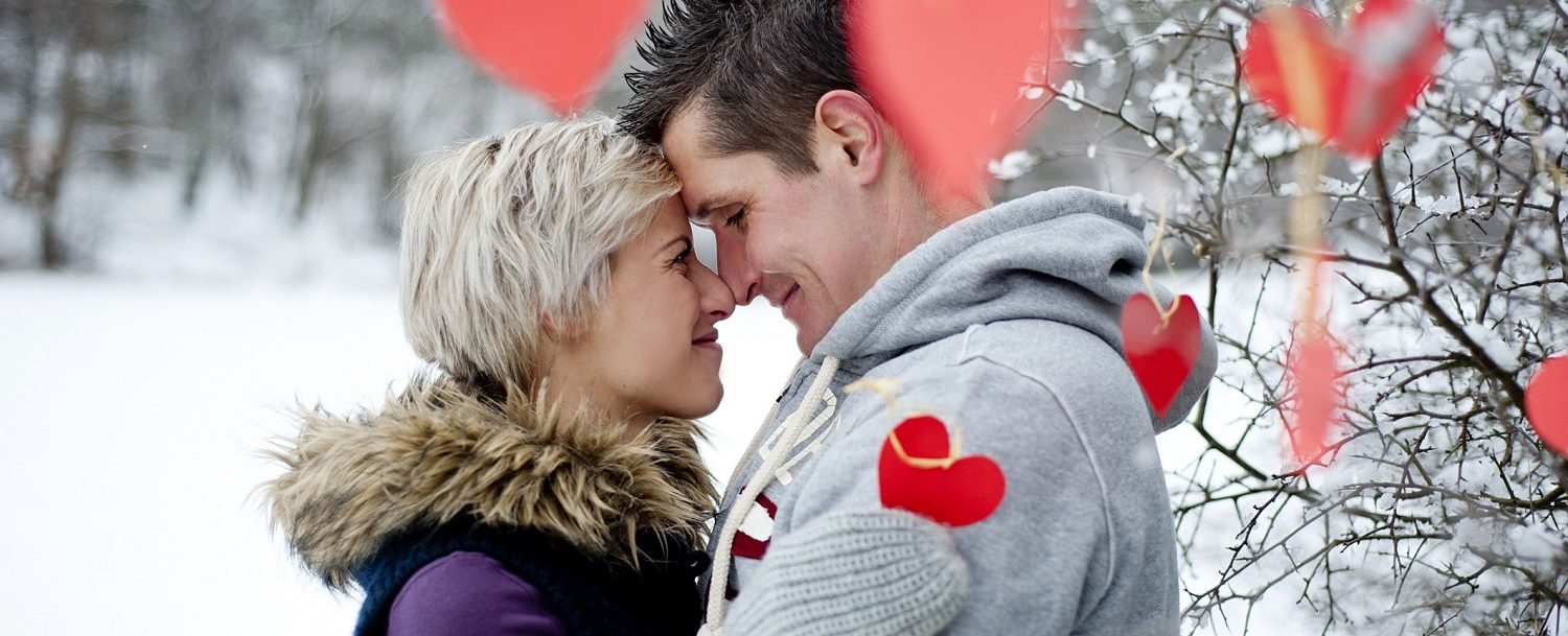 Happy couple is having romantic time in snowy countryside